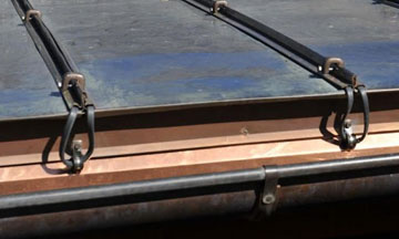 Heat Tape Metal Roofs: Heat cable is attached to metal roofs using HotEdge HotSeam to prevent ice dams on metal roofs