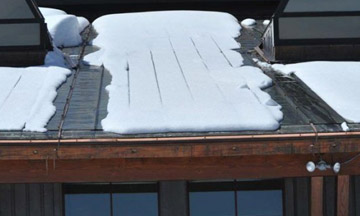 break up the snow and ice on a metal roof, deicing system for metal roofs