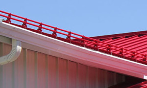 Clamp-on snow stops, standing seam metal roofs