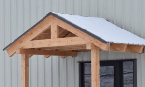 Dormer Door snow diverters, keeps falling snow and ice from barricading doorways